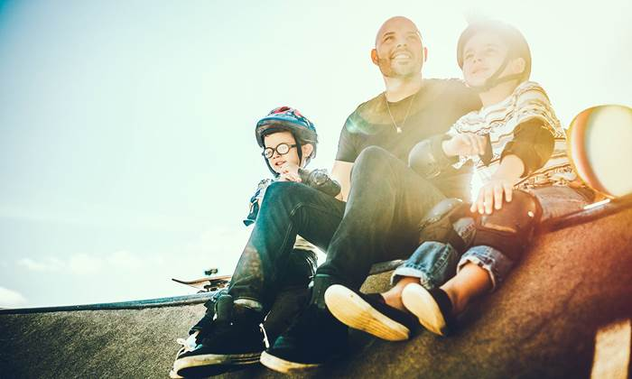 Father and sons skateboarding